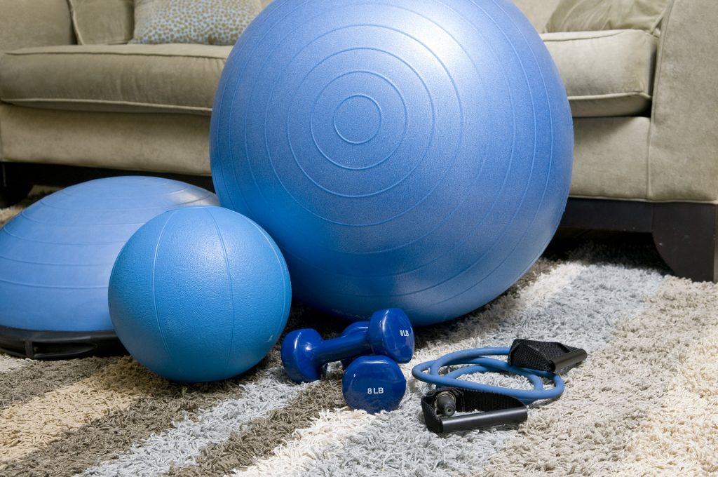photo of exercise balls and dumb bells